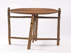French 19th Century folding Vendange (wine) or coaching table, of small proportions, the circular