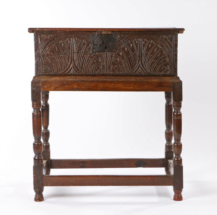 Charles I boarded oak box on later stand, circa 1640, the rectangular top above a pair of carved