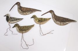 Five primitive Folk art bird decoys, early 20th Century, each painted and raised on metal stands,