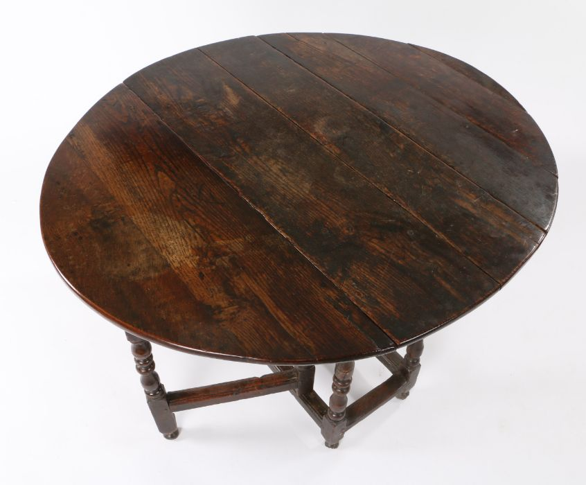 Mid 17th Century oak gateleg table, the oval drop leaf top above a moulded frieze and turned legs, - Image 3 of 3
