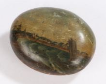 Folk art, a painted pebble depicting a sailing boat in stormy seas by a coastal town, 10cm wide