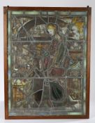 Stained glass panel, probably 16th Century elements, depicting a figure bringing theciborium to a