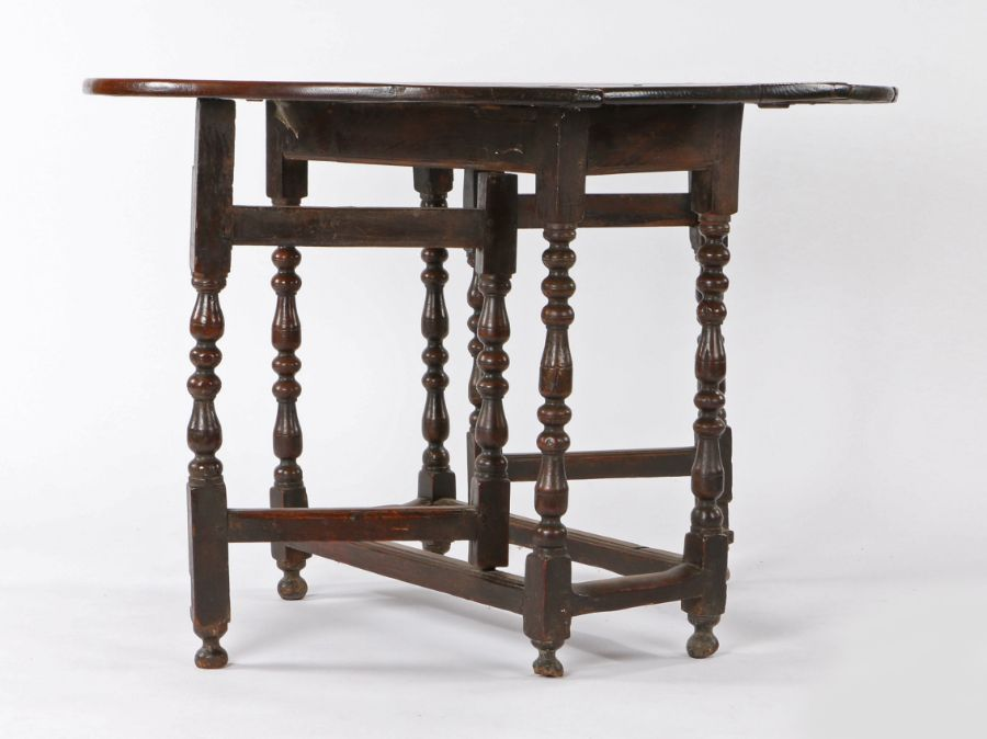 Mid 17th Century oak gateleg table, the oval drop leaf top above a moulded frieze and turned legs, - Image 2 of 3