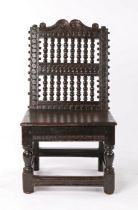 Rare Charles I oak low back stool, circa 1640, the scroll arching top rail above a series of