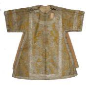 18th Century Italian Dalmatic, circa 1730, of yellow silk brocaded in coloured silks and silver