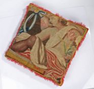 A large cushion of 18th century tapestry, designed with a classically draped youth holding a