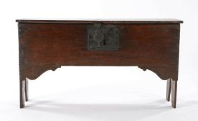 A small oak boarded chest, circa 1670, the rectangular top enclosing the storage compartment above