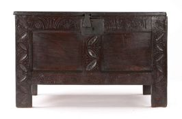 Small Charles II oak coffer, Devon, circa 1660, the rectangular top above a lunette carved frieze