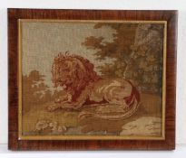 Victorian woolwork panel, of a reclining lion among tress, 28cm x 23cm