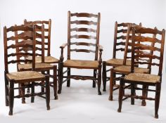 19th Century Harlequin set of seven Lancashire oak and ash ladderback chairs, with rush seats,
