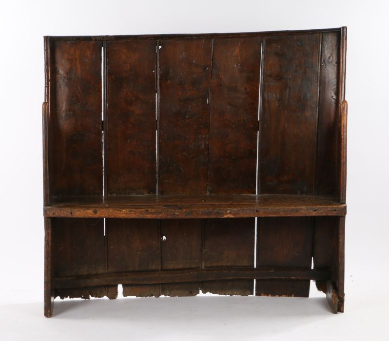 Charming George III boarded elm bow back settle, West Country, circa 1800, of small proportions, the
