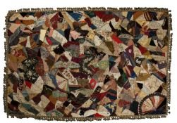 Victorian patchwork quilt, made up from silk and fabric panels from the 18th and 19th Centuries, the