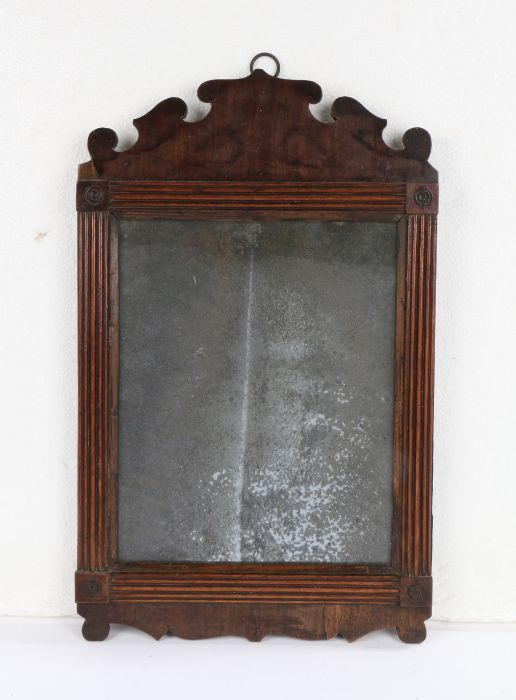 George III mahogany wall mirror, the original rectangular plate with an arched pediment above the