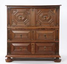Charles II oak geometric chest of drawers, circa 1670, the rectangular top above a deep moulded