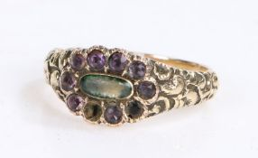 Victorian mourning ring, the head set with violet stones and a central cabochon cut stone having a