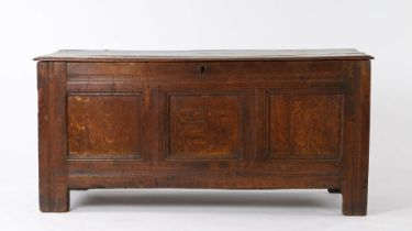 Charles I oak coffer, circa 1640, the rectangular hinged top above three panels to the front, with