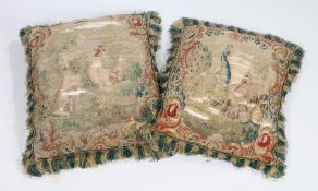 Two cushions of 18th Century tapestry, the first with a peacock and crane among foliate scrolls,