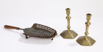 Pair of 18th Century brass candlesticks, with tapering stems and a stepped foot,17.5cm high,