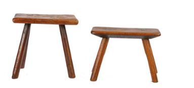 Two 19th Century elm primitive stools, the first with a rectangular top above four angled legs, 32cm