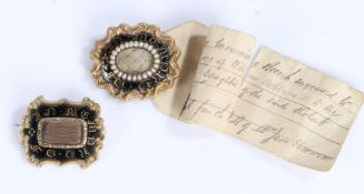 Two Victorian mourning brooches, the first with a central hair panel and black enamel surround and