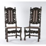 A pair of late 17th century walnut and cane side chairs, circa 1685, each back having a pair of