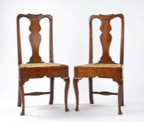 Pair of Queen Anne country made oak chairs, the arched top rail above the splat back on a rush