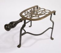 18th Century brass trivet, the brass section with a pierced design featuring an eagle with a