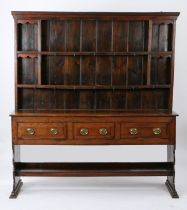 George III oak dresser base and rack, possibly Cornish, the rack with two shelves, the base with