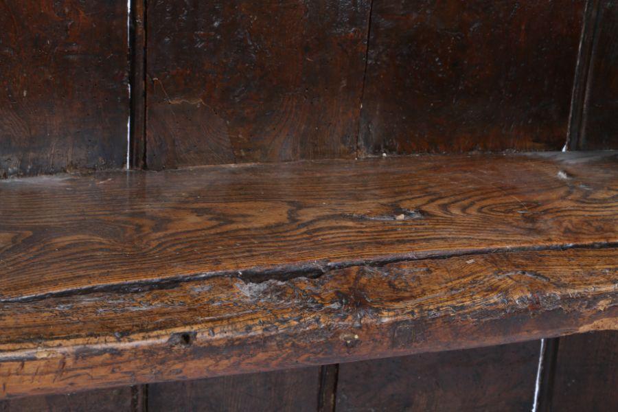 Charming George III boarded elm bow back settle, West Country, circa 1800, of small proportions, the - Image 10 of 12