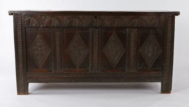 Charles I oak boarded coffer, West Country, circa 1640, the rectangular top with chip carved edge