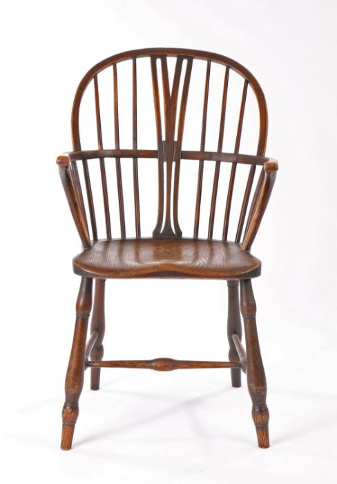 19th Century elm armchair, the arched top rail above a central splat and spindles, the solid seat
