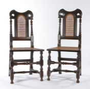 A pair of William & Mary oak and cane side chairs, circa 1690, of rare form, each with a dished,