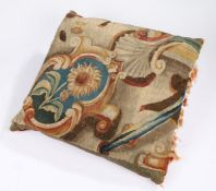 A large cushion of 18th century tapestry, designed with a sunflower within a cartouche, backed