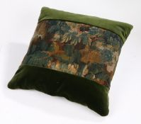A large cushion of 17th century verdure tapestry and velvet, of foliate design in typical palette of