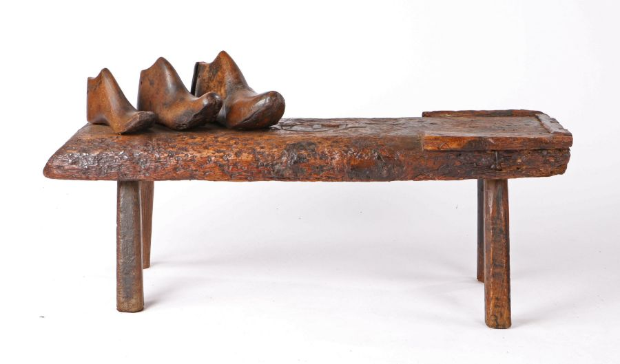 19th Century cobblers bench, the rectangular top with leather strap work to the centre and one end