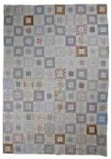 American patchwork quilt, circa 1900, with square sections each containing hand written bible