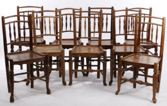 Matched set of nine 19th Century oak and elm chairs, with spindle backs above plank seats and turned