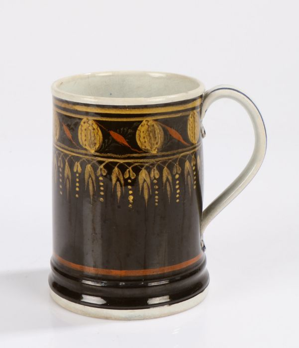 George III Mocha ware mug, circa 1800, the cylindrical mug with a brown body with berry and drop