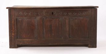 Charles II oak coffer, the hinged rectangular top enclosing a candle box and storage space, the