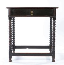 A small Charles II oak side table, circa 1670, having a one-piece top, the frieze drawer with half-