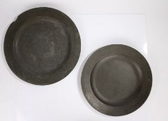 Two 18th Century pewter chargers, the first London with the impressed initials to the underside edge