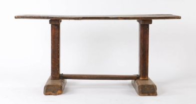 An 18th Century and later Tavern type table pine and elm table, the rectangular top with rounded