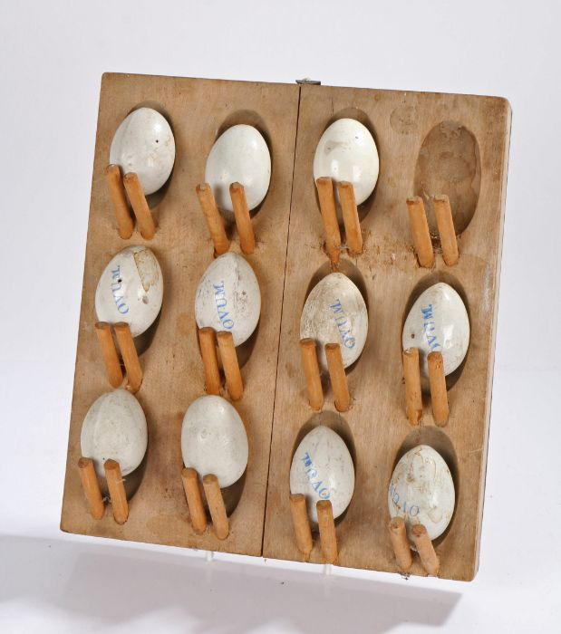 """Early 20th Century set of Hen """"pot"""" eggs, the pottery eggs some named Ovum in pale blue placed"""