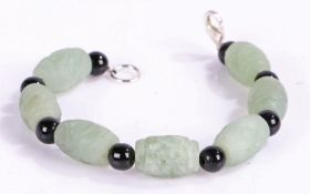 Carved Jade bracelet intersecting black stones, 20cm long