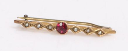9 carat gold pearl and ruby bar brooch, with a central ruby flanked by three pearls either side,