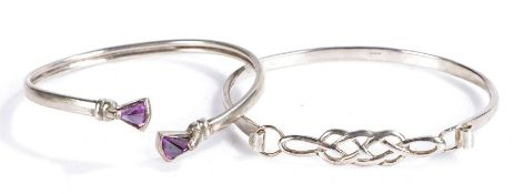 Two silver bangles, one with Celtic design the other set with two amethysts (2)