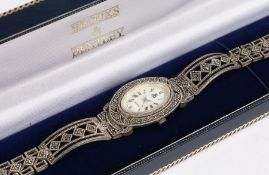 Brooks and Bentley ladies silver wristwatch, the signed mother of pearl dial with Roman numerals,