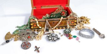 Collection of costume jewellery to include a ladys wristwatch necklaces and bracelets housed in a