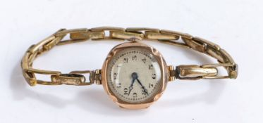 9 carat gold ladies wristwatch, the engine turned effect dial with Arabic numerals, manual wound,