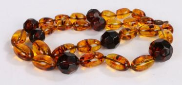 Amber bead necklace, with oval and facetted beads, 76cm long, 104.7g